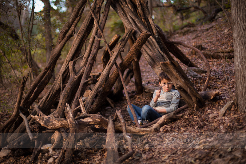 Boy in a wood teepee during Houston Metro family session