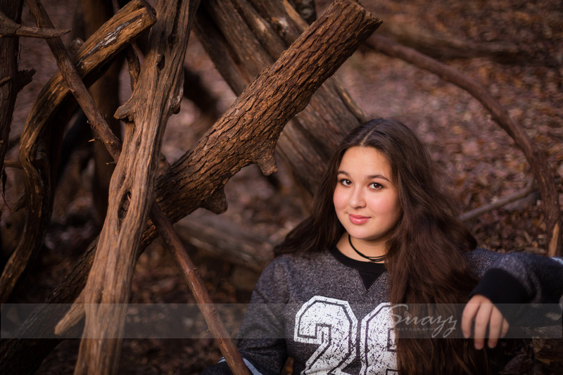 Houston Metro teen girl in wood teepee during outdoor family photo session